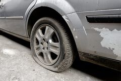 Flat rear tire on car Stock Photo
