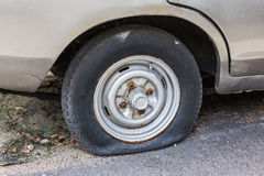 Flat rear tire on car.  Stock Image
