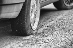 Flat rear tire on a car Royalty Free Stock Photo