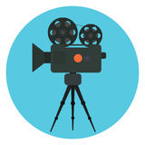Flat  retro cinema camera with film strip in bobbin icon. Cinematography symbol. Flat  retro cinema camera with film strip in bobbin and red button icon Royalty Free Stock Photos