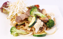 Flat rice noodle stir fried with oyster sauce and fresh vegetabl Stock Images