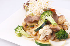 Flat rice noodle stir fried with oyster sauce and fresh vegetabl Royalty Free Stock Photo