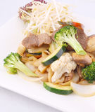Flat rice noodle stir fried with oyster sauce and fresh vegetabl Royalty Free Stock Images