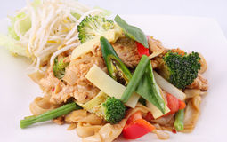Flat rice noodle stir fried with Thai herb  and basil. Stock Image