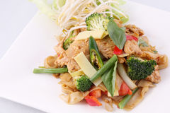 Flat rice noodle stir fried with Thai herb  and basil. Stock Photo