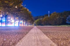 Flat road at night lights. Selective focus stock photos