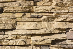 Flat rocks layered to form a solid wall Stock Images