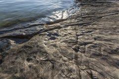 Flat rocky surface  on shore Stock Image