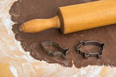 Flat rolled out dough, rolling pin and cookie cutters stock image