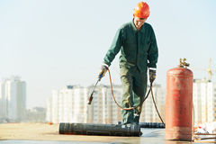 Flat roof covering repair works with roofing felt Stock Image