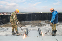 Flat roof covering works Stock Photos
