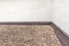 Flat roof. Filled with boulders on the roofing Royalty Free Stock Images