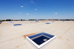 Flat roof on industrial hall Stock Photos