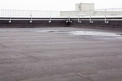 Flat roof with roofing. An flat roof with roofing and fencing stock images