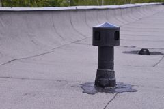 Flat roof ventilation, waterproofing ant protection . Aerator on Roofing felt. Closeup detail shoot. Flat roof ventilation, waterproofing ant protection Stock Photography