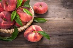 Flat saturn peaches. On the wooden table Stock Photo