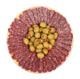 Flat sausage. In plate garnished with olives on a white background Royalty Free Stock Images