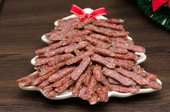 Flat sausage in a white plate Royalty Free Stock Photo