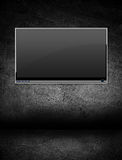 Flat screen television in a dark room. Alone black cable cinema communication concept royalty free stock photography