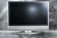 Flat screen television in a metal background Royalty Free Stock Image