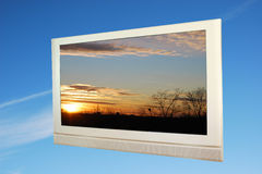 Flat screen TV. On sky background.  Paths on screen and outline Royalty Free Stock Images