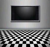 Flat screen tv. Hanging in a modern room Royalty Free Stock Photography
