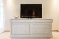 Flat screen TV on cabinet Stock Photos
