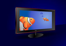 Flat screen tv with fishes on the screen Stock Photography