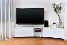 Flat screen TV. Large flat screen TV in modern interior living room Royalty Free Stock Photo