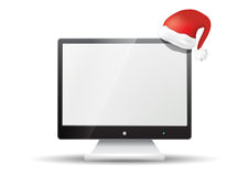 Flat screen tv with santa claus hat Stock Photography