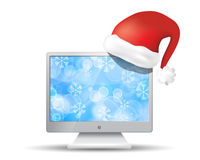 Flat screen tv with santa claus hat Stock Images