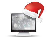 Flat screen tv with santa claus hat Stock Photo