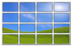 Flat screens displaying field and sky. Royalty Free Stock Image