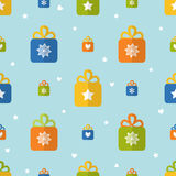 Flat seamless pattern with presents. Seamless pattern with gift boxes in flat style Royalty Free Stock Photo