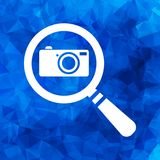 Flat search icon with photo camera on a blue triangular polygona Stock Photo