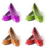 Flat shoes. Collection of four woman flat shoes in different tint / colors: brown, red. pink and green Stock Photos
