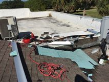 Flat and Slope Roof Repairs in Progress and Tools; Roofer Royalty Free Stock Image