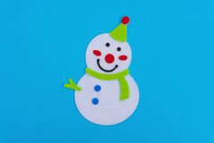Flat smiling toy christmas snowman with green scarf Stock Photo
