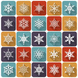 Flat snowflakes. Vector icons set. Flat snowflakes. Set of 25 white icons with long shadows. Elements of various shape for your design. Vector illustration Royalty Free Stock Photo