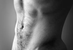 Flat sporty male belly. Closeup black and white photo with shallow depth of field Stock Images