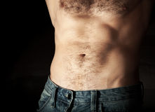 Flat sporty male belly on dark background Royalty Free Stock Image