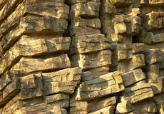 Flat stacked stones. Closeup of flat stacked stones in a wall Royalty Free Stock Photos