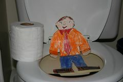 Flat Stanley on the Toilet stock image