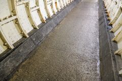 Flat stone floor and heavy iron plating on Thames under water tunnel wall.  stock photos