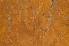 A flat stone surface rusting due to the iron ore it contains. A rust pattern / texture with marble like structure. A rust structure on a corroded flat stone Stock Images