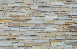 Flat stones wall background. Close up of decorative gray flat stones wall texture Stock Photos