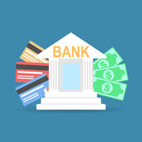 Flat style bank building with credit cards and currency notes Royalty Free Stock Photo