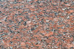 The flat surface of a natural marble or brown granite slab. On the surface there are many small cracks, streaks, stripes and dots. Background, Wallpaper or royalty free stock photography