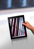 Flat tablet pc. Working with a modern flat tablet pc Royalty Free Stock Photography