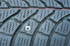Flat tire. Due to a screw in the tire Royalty Free Stock Image